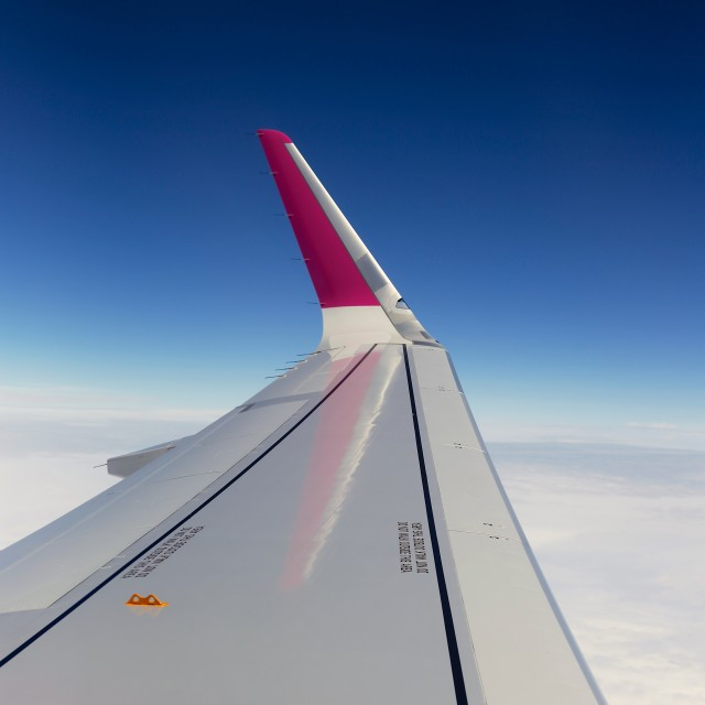 """""""Airplane Window Seat View Over Wing Whilst Flying"""" stock image"""
