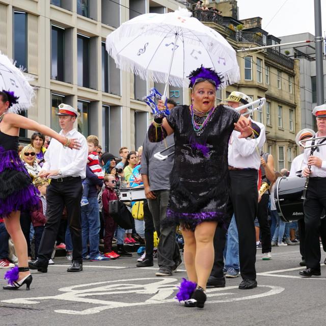 """Woman performs at Edinburgh Jazz festival parade"" stock image"