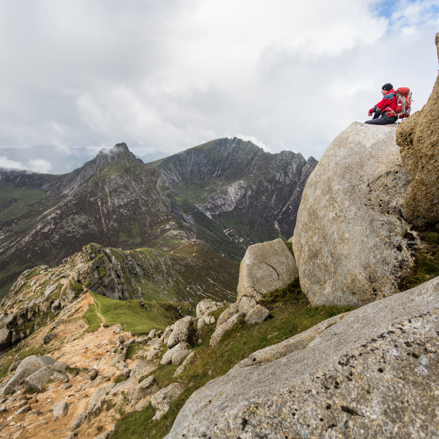 """Hillwalker seated on Goat Fell"" stock image"