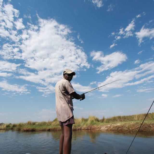 """Man fishing in Botswana"" stock image"
