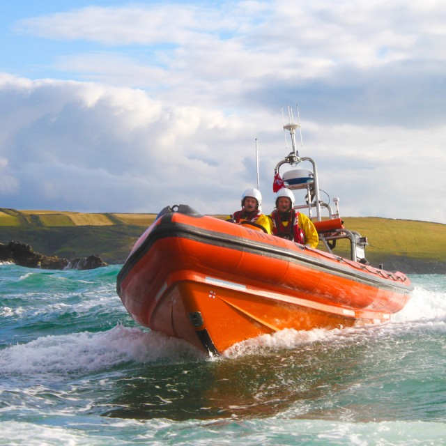 """RNLI Atlantic 85 lifeboat The Gladys Mildred backing up the Atkinson Trophy Gig Race 2015 Newquay Cornwall"" stock image"