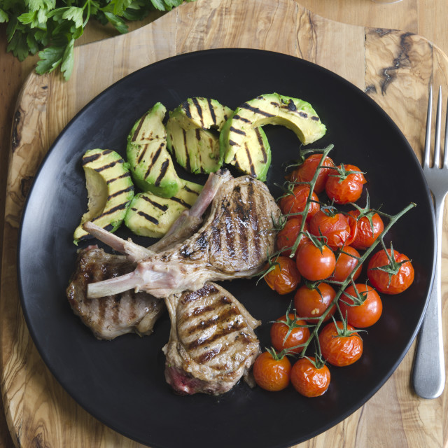 """Lamb cutlets with avocado and tomatoes"" stock image"