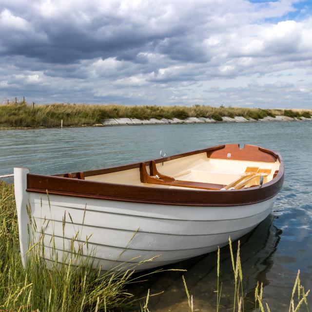 """Dinghy moored in the Creek"" stock image"