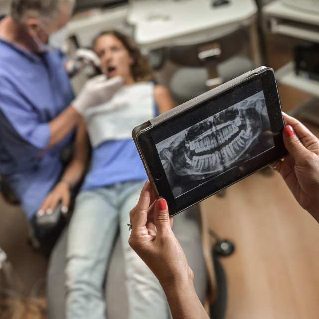 """Dentist Office-Digital tablet with a patients x-rays"" stock image"