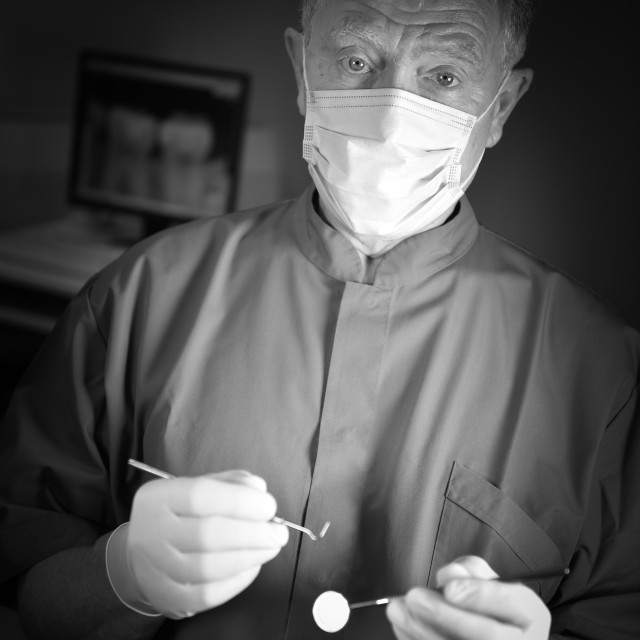 """Dentist doing dental examination"" stock image"