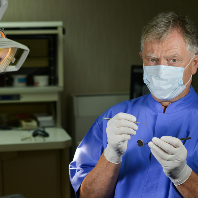 """Dentist doing dental examination"" stock image"