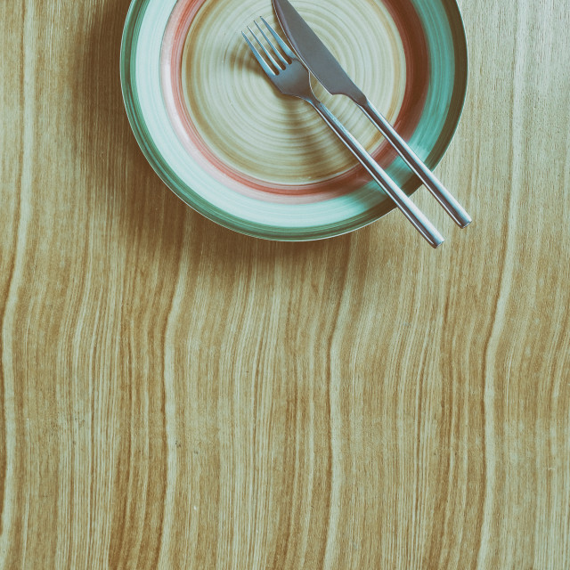 """Knife, fork and plate on a table"" stock image"