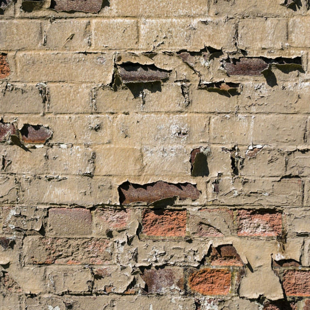 """""""Crumbling Brick Wall"""" stock image"""