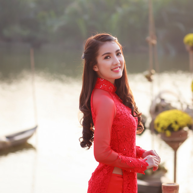 """Vietnamese girl wearing Red Ao dai in the spring lunar new year holiday"" stock image"