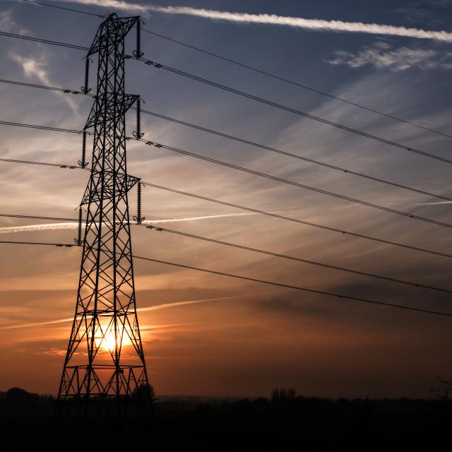 """Electricity pylon at Sunset."" stock image"