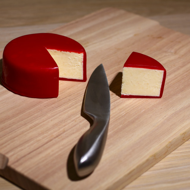 """""""Cheese on chopping board"""" stock image"""