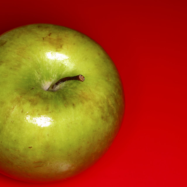 """Apple on red"" stock image"