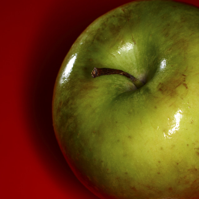 """""""Apple on red"""" stock image"""