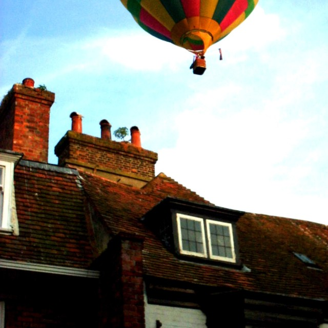 """Hot air balloon over Rye, UK"" stock image"