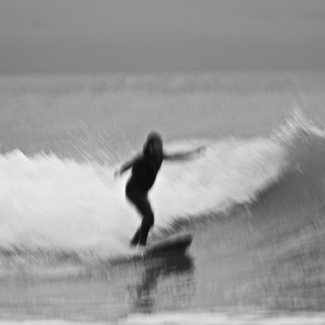 """abstract surfer riding a wave"" stock image"