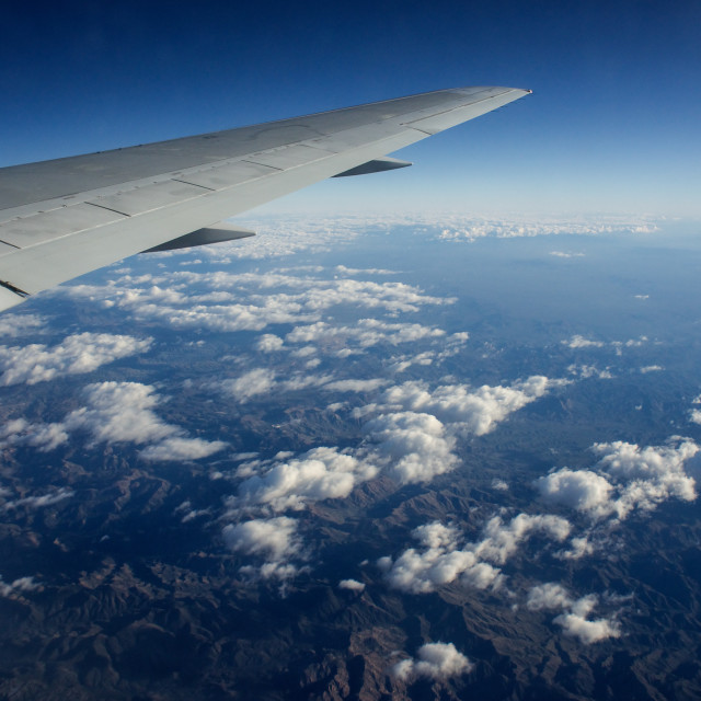 """Rocky mountains from a passenger jet"" stock image"
