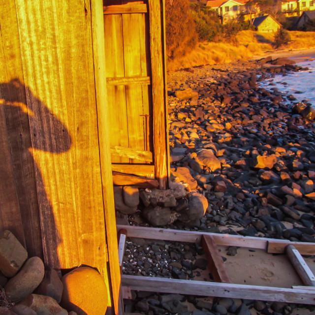 """""""Photographers Shadow on Boatshed"""" stock image"""