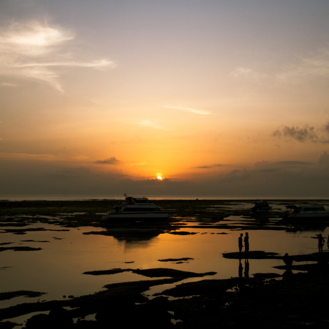 """Sunrise in Sanur Bali"" stock image"