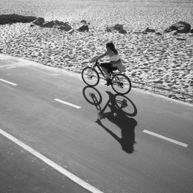"""Cyclist and shadow"" stock image"