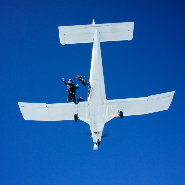 """Skydivers exiting a plane"" stock image"