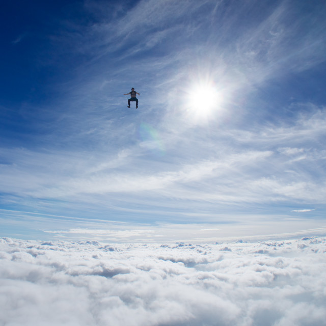 """Skydiver above the clouds"" stock image"