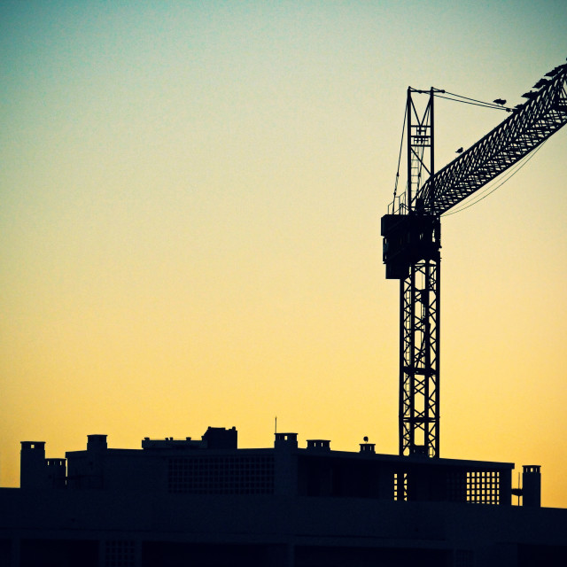 """Crane and building Silhouette"" stock image"