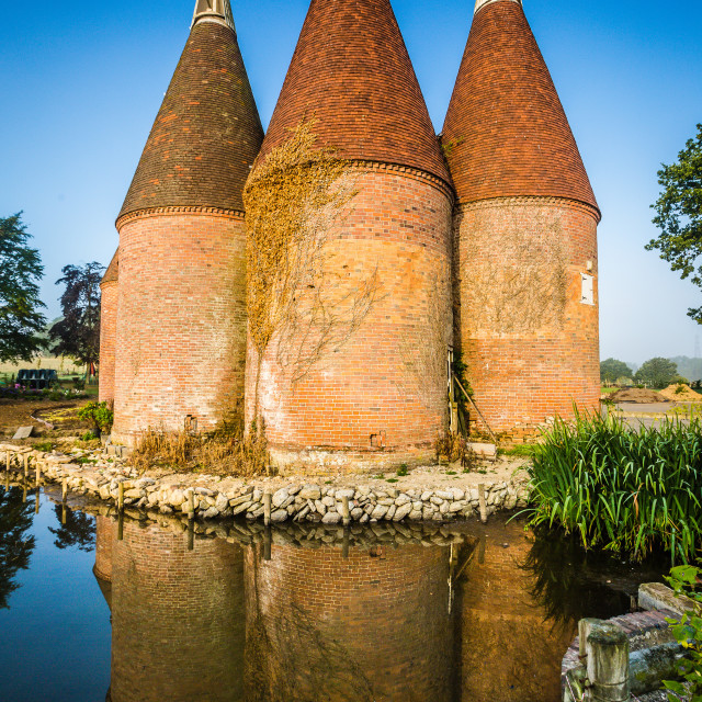 """Reflected Oast Barns"" stock image"