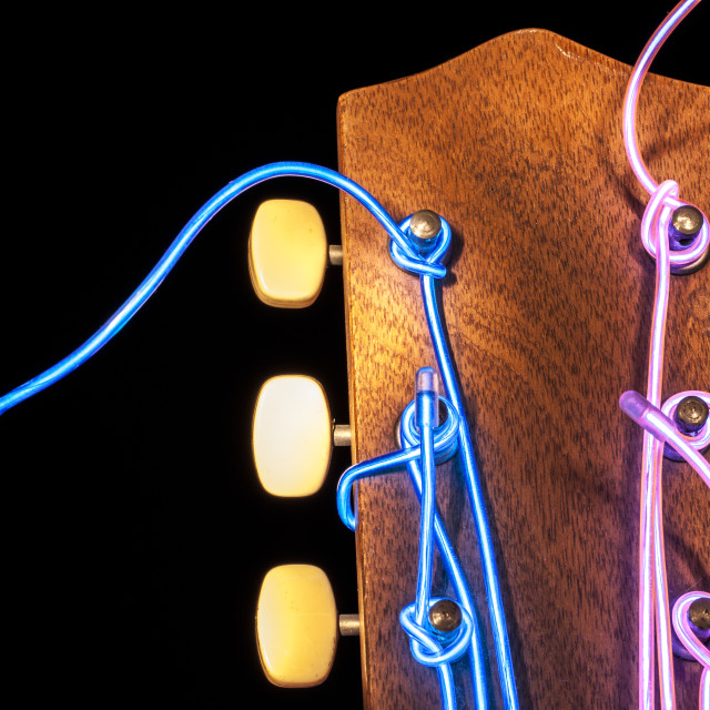 """Guitar with glowing strings"" stock image"