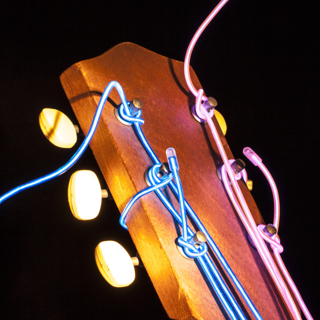 """""""Acoustic guitar with glowing strings"""" stock image"""