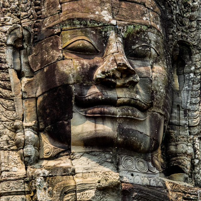 """Cambodia ancient rock face"" stock image"