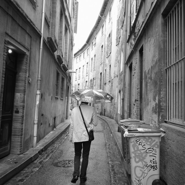 """Man under the rain"" stock image"