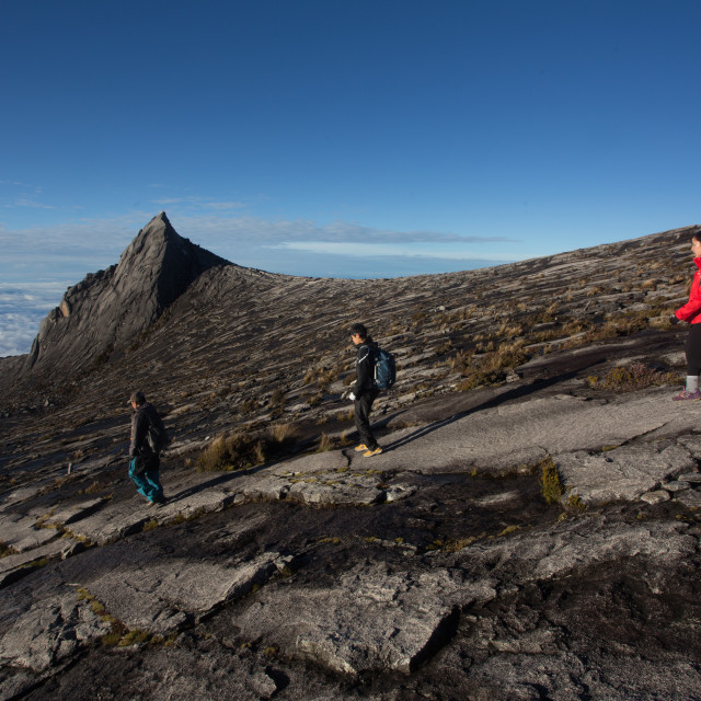 """Hikers at the top of Mount Kinabalu in Sabah, Malaysia."" stock image"