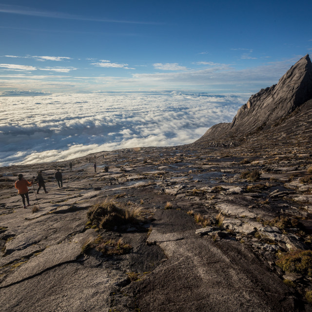 """Hikers at the top of Mount Kinabalu, Borneo."" stock image"