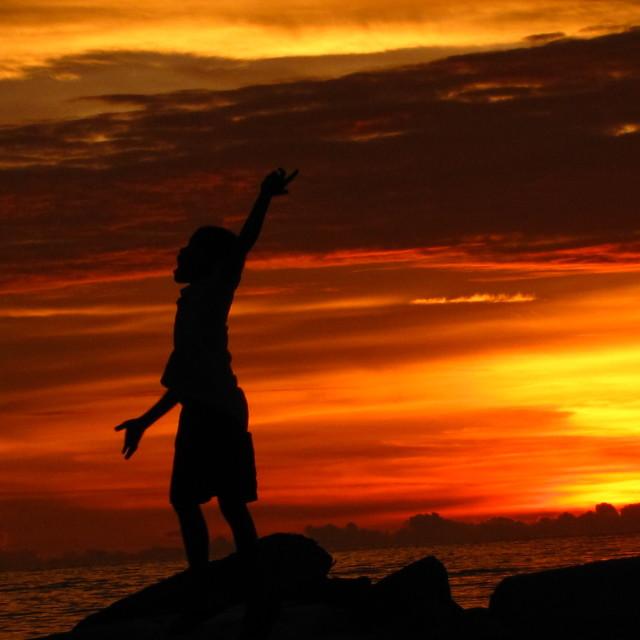 """""""Sunset Boy"""" stock image"""