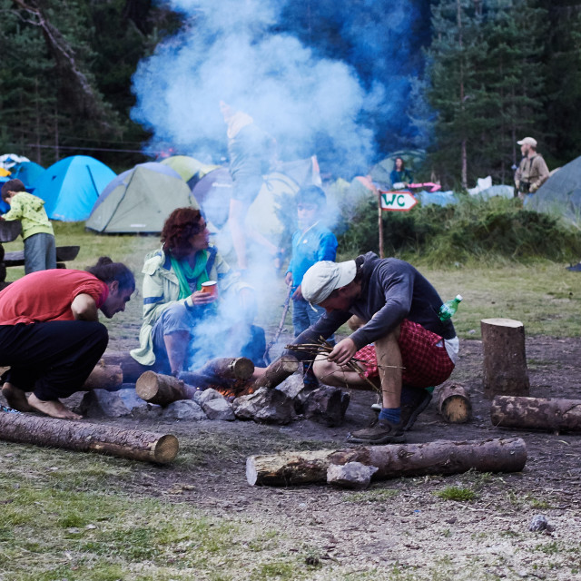 """""""Setting up a campfire"""" stock image"""