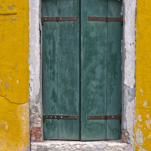 """Yellow Wall and Green Shutters"" stock image"