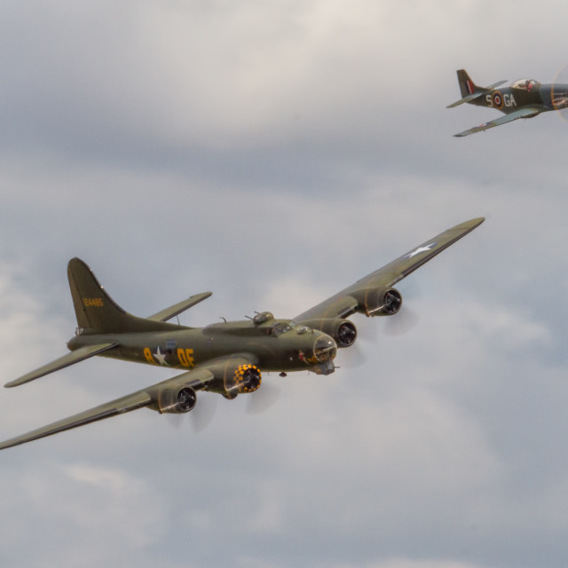 """B17 escorted by Mustang"" stock image"