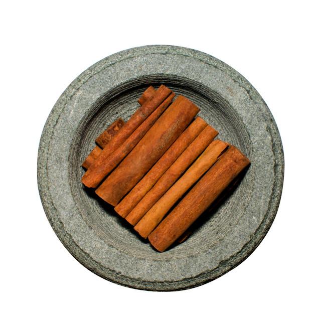 """Cinnamon in stone spice grinder"" stock image"