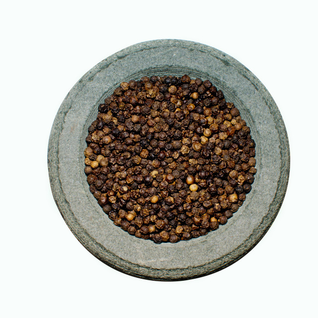 """Black pepper in stone spice grinder"" stock image"