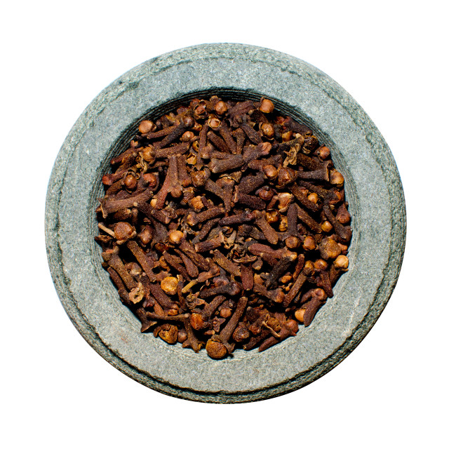 """Cloves in stone spice grinder"" stock image"