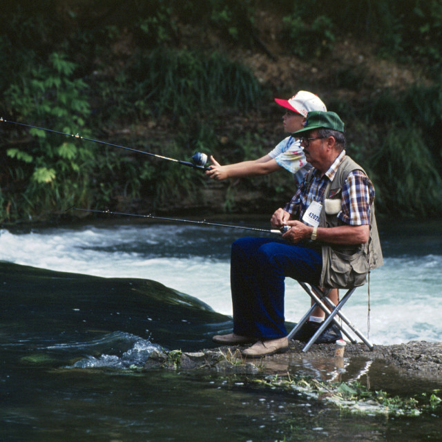 """Grandfather and Grandson Fishing"" stock image"