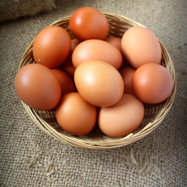 """Eggs in basket"" stock image"
