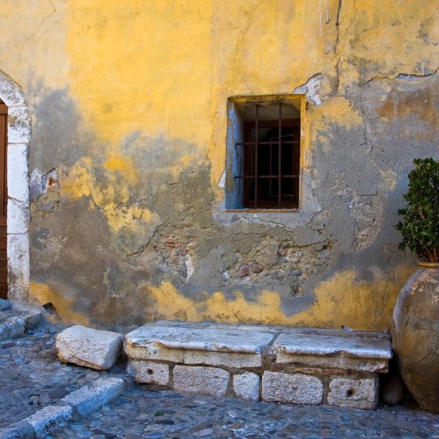 """""""Yellow Wall with Urn"""" stock image"""