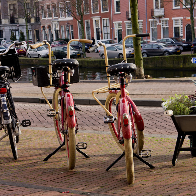 """""""A trio of bicycles, and a wheelbarrow"""" stock image"""