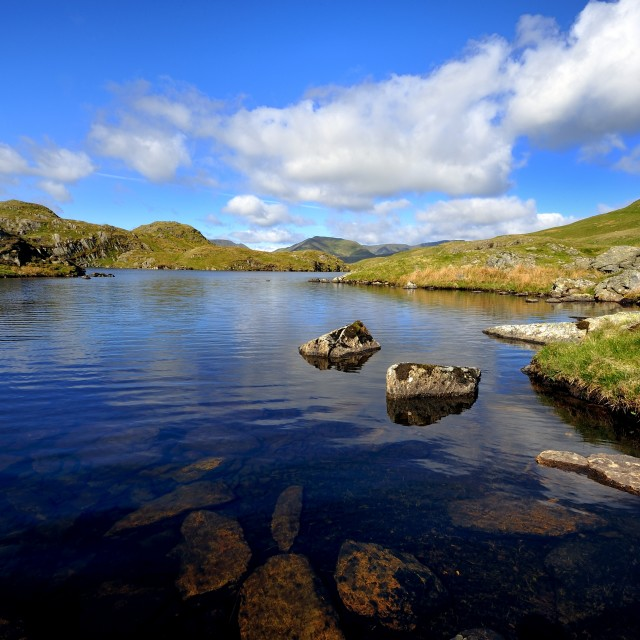 """Reflections in Angle Tarn"" stock image"