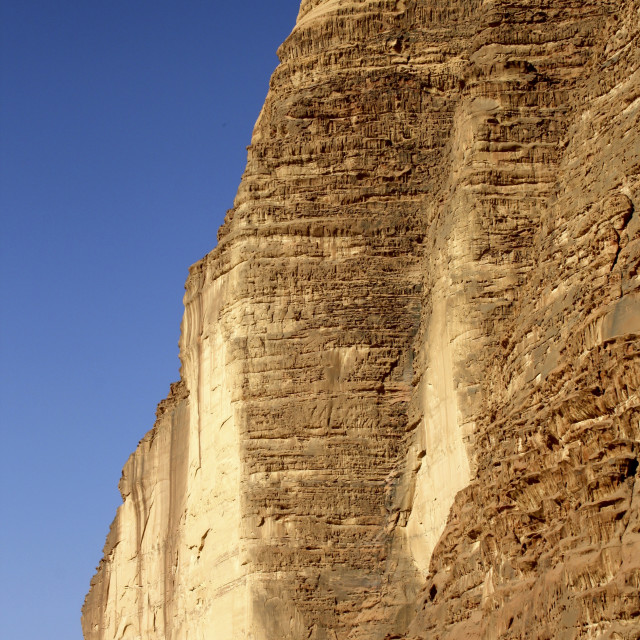 """Cliff face in Wadi Rum, Jordan"" stock image"