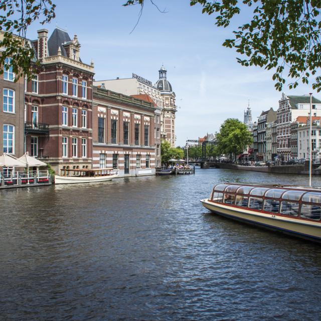 """Amsterdam canal / river boat scene"" stock image"