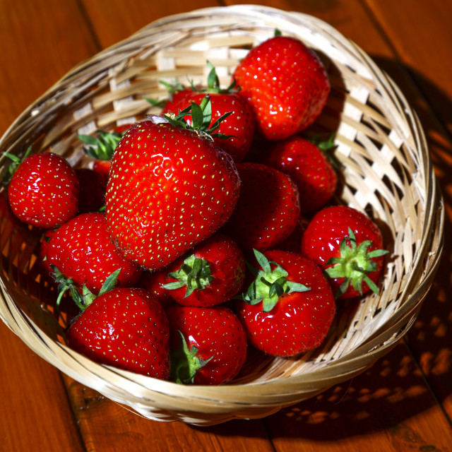 """Ripe strawberries in a basket"" stock image"