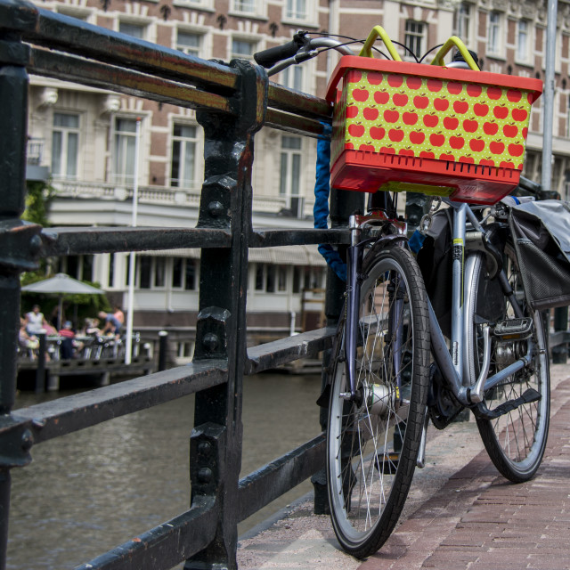 """Unusual bicycle parked by canal in Amsterdam"" stock image"
