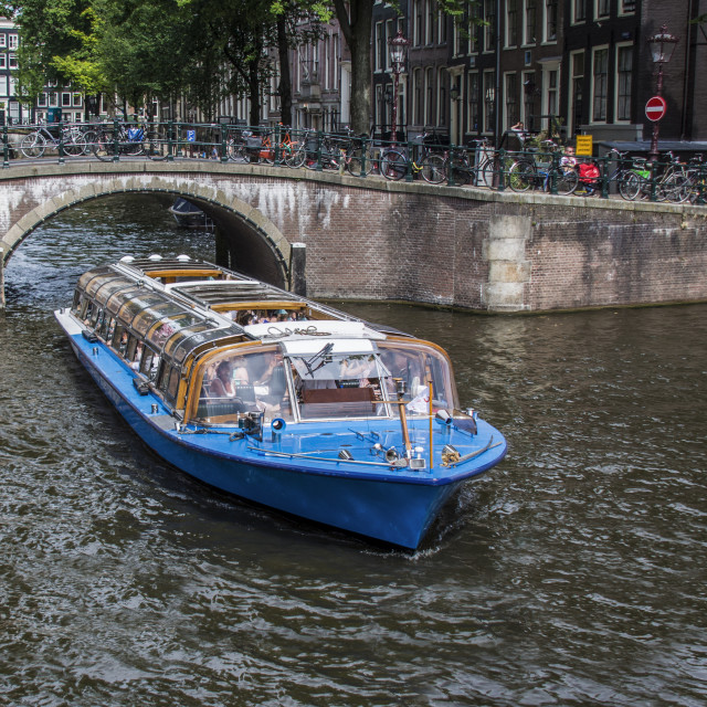 """""""Canal boat showing tourists around Amsterdam"""" stock image"""
